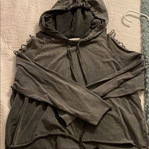 Hoodie with ripped shoulders.